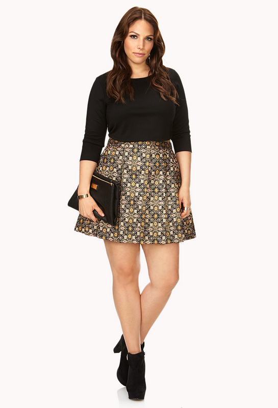 70a27c50320 This woven skater skirt features an allover daisy print with a concealed  side zipper. Find