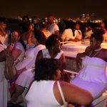 Guests relax on the rooftop of the Boat