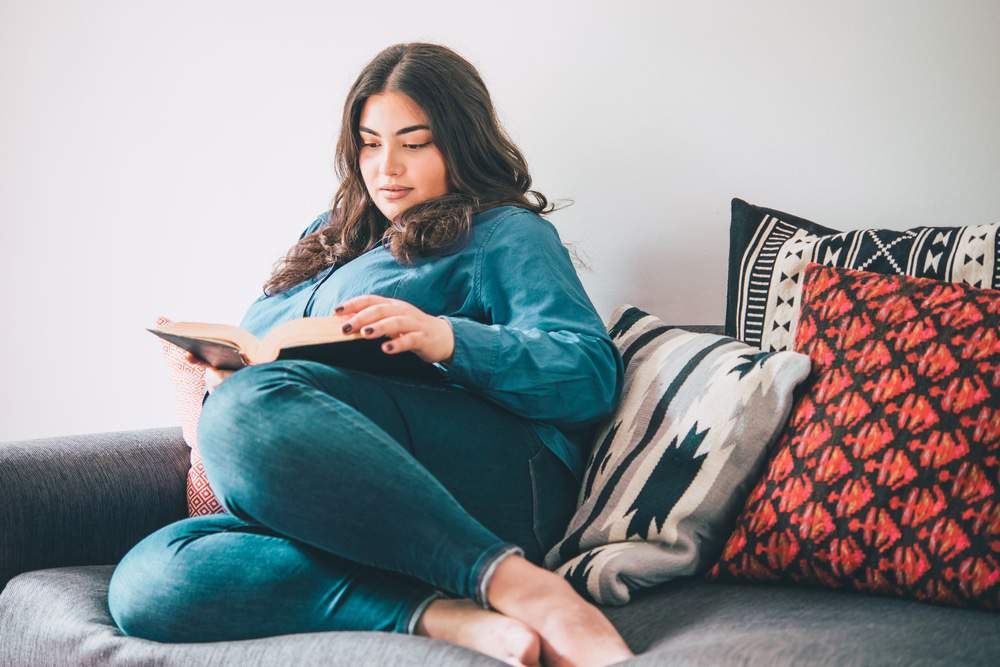 plus size woman reading a book