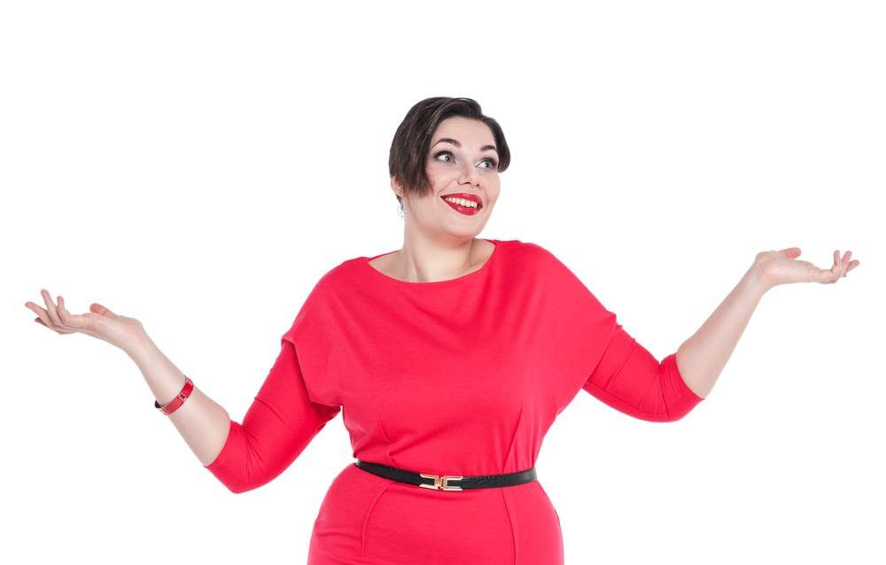 83531225ae984 Beautiful plus size woman in red dress shrugs her shoulders isolated