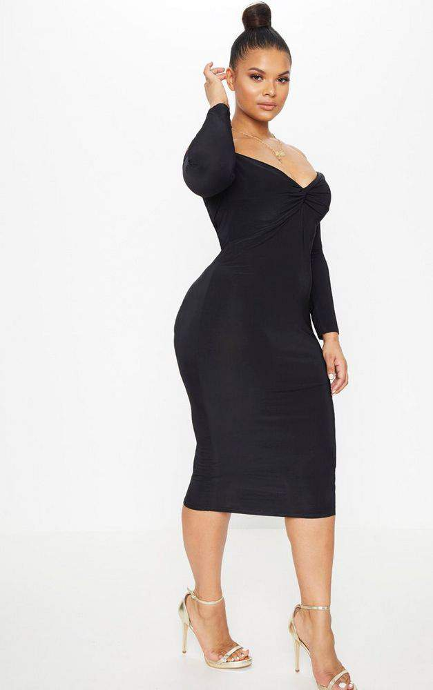 How many plus size little black dresses do you own? We are having a little fun in this Premme Plus size little black dress and sharing a few more LBD finds!
