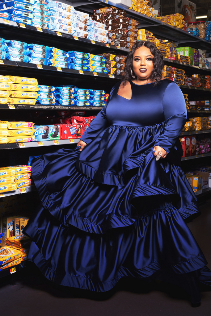 Plus size designer, Courtney Noelle in 2019 Holiday COllection, Uncomfortable in a blue satin dress